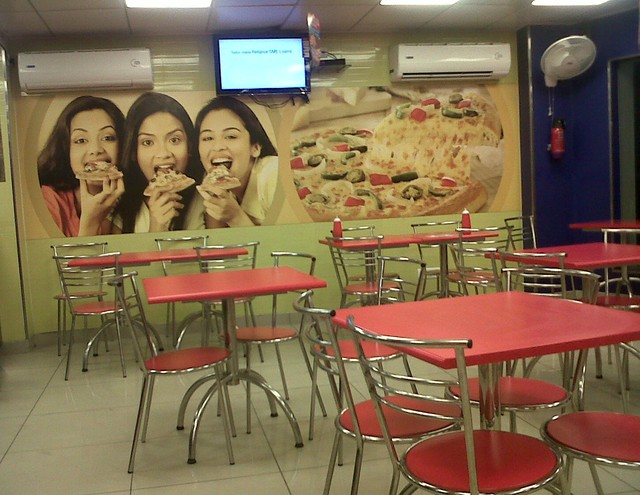 Pizza ladies on the wall.
