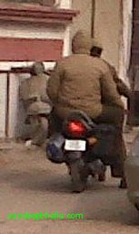 Policement not wearing helmet.